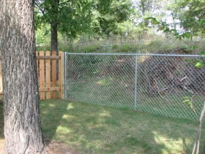 Residential chainlink and wood fence by Pickens Fence